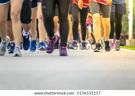 Chiang Mai, Thailand - June 17th, 2018 : Group of Chiang Mai people feet running in marathon running race on June 17th, 2018 in Chiang Mai Thailand #1136531117