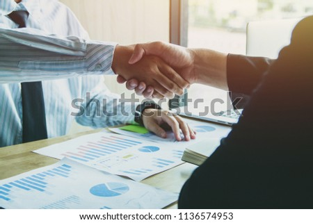 Group asia businessman together create a mutually beneficial business relationship. Economic graph on the table #1136574953