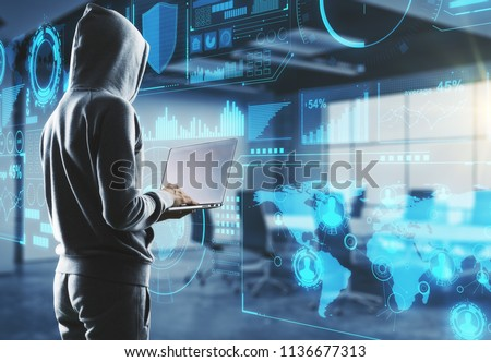 side view on hacker in process with laptop and big digital screen with cyberspace illustration. #1136677313
