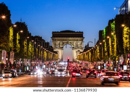 Paris, France - June 25, 2017: The Avenue des Champs Elysees and Arc de Triomphe (Arch of Triumph of the Star) in the summer at night. #1136879930
