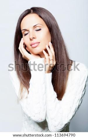 Beautiful brunette woman in studio #113694790