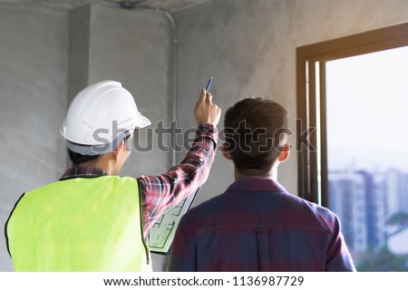 Client and Contractor discussing plan to renovation house. #1136987729
