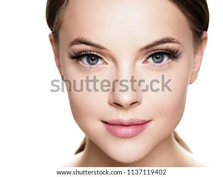 Eyelashes woman eyes face close up with beautiful long lashes isolated on white Royalty-Free Stock Photo #1137119402