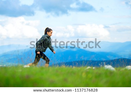 Beautiful athletic woman running in forest #1137176828