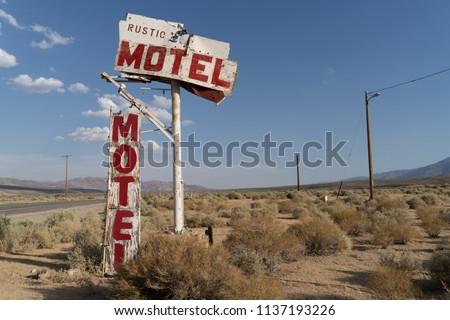 Abandoned generic rustic motel sign is falling apart and decaying in the California desert, near Olancha, CA #1137193226