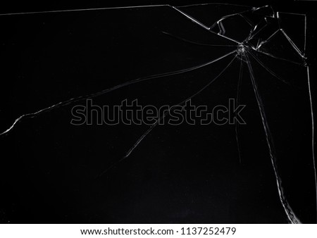 A broken glass on a dark surface, with many sharp shards. Useful texture overlay.  #1137252479