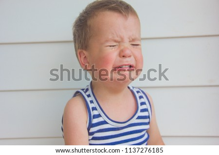 The baby is crying. The little boy is crying heavily. #1137276185