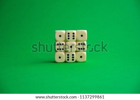 dice on a green background #1137299861