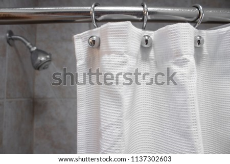 a white shower curtain in an empty shower with water ON closeup shot #1137302603