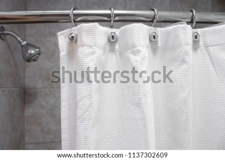 a white shower curtain in an empty shower with water OFF medium shot #1137302609