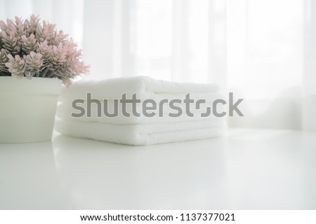 Towels on white wood top table with copy space on blurred bathroom background. For product display montag #1137377021