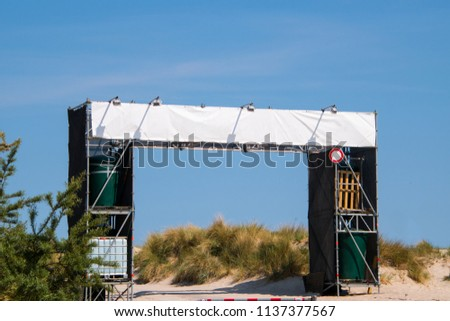 Large blank white banner over entrance to a beach