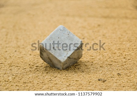 concrete cube in sand. cube concrete sample for testing in wet sand. abstraction, conception #1137579902