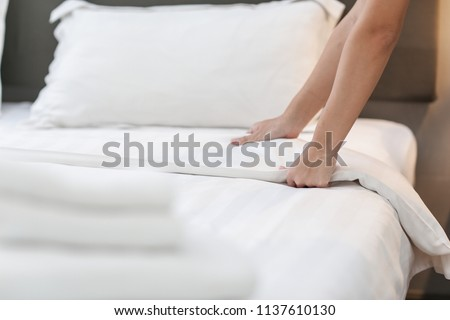 Hands Making Bed from Hotel Room Service #1137610130