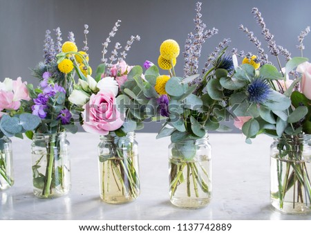 Flowers in jar, beautiful bouquet on table on gray background  #1137742889