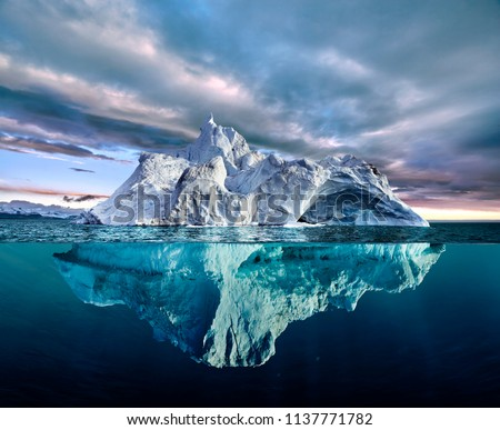 iceberg with above and underwater view taken in greenland #1137771782