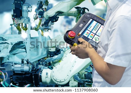 iot smart factory , industry 4.0 technology concept, robot arm in automation factory background with fake sunlight on operation line, Futuristic in the new trend technology #1137908060