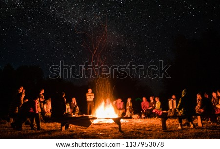 beautiful scenery of night vision. bonfire around people. basking by the fire at night. the concept of outdoor activities. #1137953078