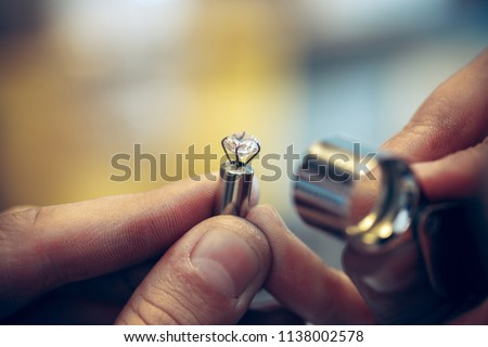 Different goldsmiths tools on the jewelry workplace. Jeweler at work in jewelry. Desktop for craft jewelry making with professional tools. Close up view of tools. #1138002578