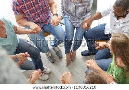 People putting hands together indoors. Unity concept #1138016210