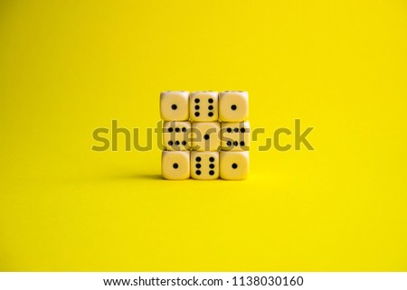 dice on a yellow background #1138030160