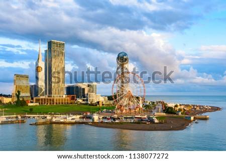 Beautiful Batumi, Georgian resort city and port at Black Sea – panoramic view of city centre from sea in golden summer morning sunlight #1138077272