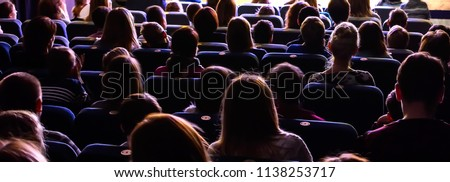 People in the auditorium watching the performance. The audience in the theater. Royalty-Free Stock Photo #1138253717