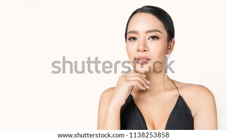Closeup portrait young beauty asian model fashion girl with diamond earrings black dress. Beautiful face clean fresh perfect skin woman. Facial treatment makeup cosmetic healthcare spa concept banner #1138253858
