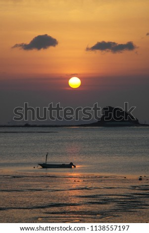 sun rises on the western coast of Korea near Incheon International Airport. The small island is called 'Shark' because it looks like a tail of a shark. #1138557197