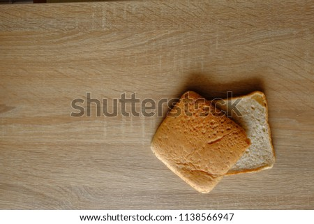 Whole wheat bread on wood table #1138566947