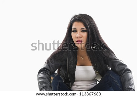 Attractive young Asian woman in casual modern clothing relxing sitting on the floor in studio #113867680