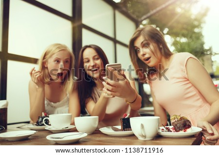 Two girl friends spending time together drinking coffee in the cafe, having breakfast and dessert. Youth, lifestyle, communication concept #1138711916