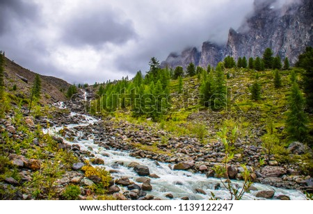 Mountain river valley landscape. Fog in mountain river valley panorama. Mountain river stream view #1139122247