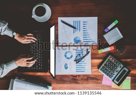 newsletter concept Hand of businessman checking message box on digital laptop Vintage tone filter.Top view #1139135546