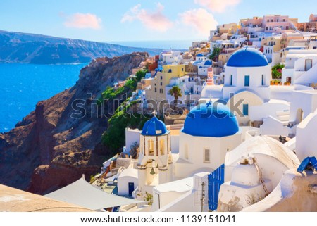 Santorini island, Greece. Oia town traditional white houses and churches with blue domes over the Caldera, Aegean sea. #1139151041