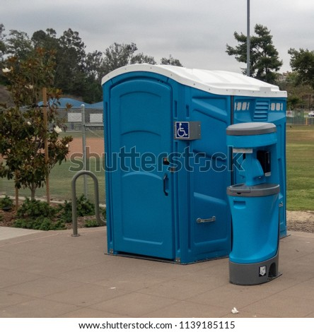 Handicap Portable Toilet in a Park #1139185115