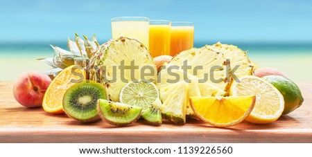 Fruit and fruit juices on background sea. #1139226560