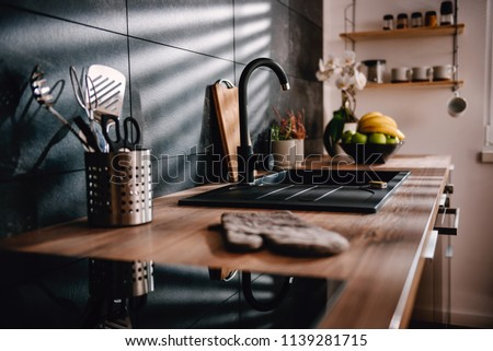 Modern kitchen with black sink and fronts #1139281715