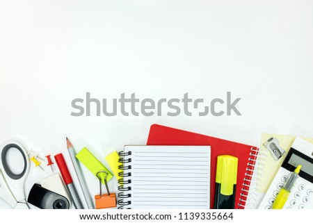 various office stationary and supplies on white background. flat lay, top view #1139335664