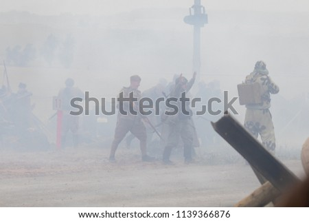 MINSK, REPUBLIC OF BELARUS - JULY 2, 2018: Military combat reconfiguration, Operation Bagration during World War II Reconstructors German and Russian soldiers, equipment on the battlefield. #1139366876