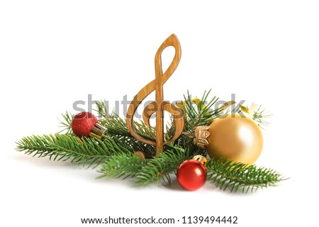 Wooden treble clef and decorations on white background. Christmas music concept #1139494442