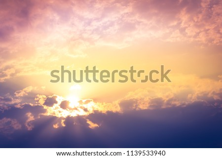 sunset with orange and yellow light in sky with soft clouds #1139533940