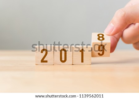 New year 2018 change to 2019 concept. Hand flip over wood cube block #1139562011