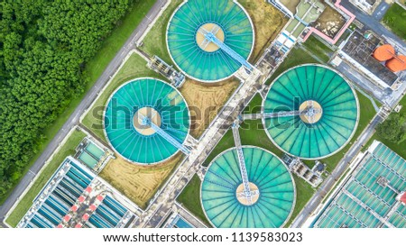 Aerial top view recirculation solid contact clarifier sedimentation tank, Water treatment plant. #1139583023