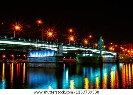 bridge is lit up at night #1139739338