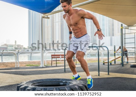 Young athletic man training outdoors - Young adult doing a fitness workout #1139752952