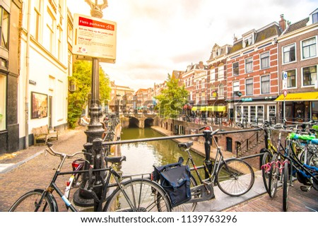 UTRECHT, NETHERLANDS - 11 July 2018: Traditional houses on the Oudegracht (Old Canal) in center of Utrecht, Netherlands. #1139763296