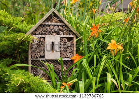 Insect house - hotel in a summer garden Royalty-Free Stock Photo #1139786765