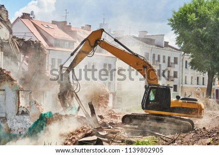 excavator crasher machine at demolition on construction site Royalty-Free Stock Photo #1139802905