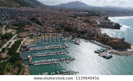 Aerial picture beautiful Mediterranean coastline town and marina showing the bay and the mountain coast town and the marina filled with docked sea yachts beautiful azure blue colored ocean